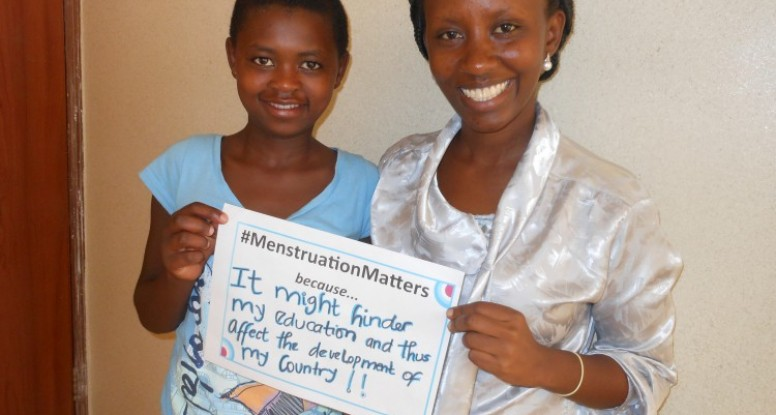 #MenstruationMatters sign with Nadia and teen girls