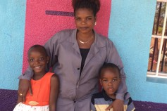 Marie Louise Umulisa with her children