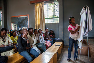 She trained 50 CHWs in health and hygiene education and they reached 5,000+ Rwandans.